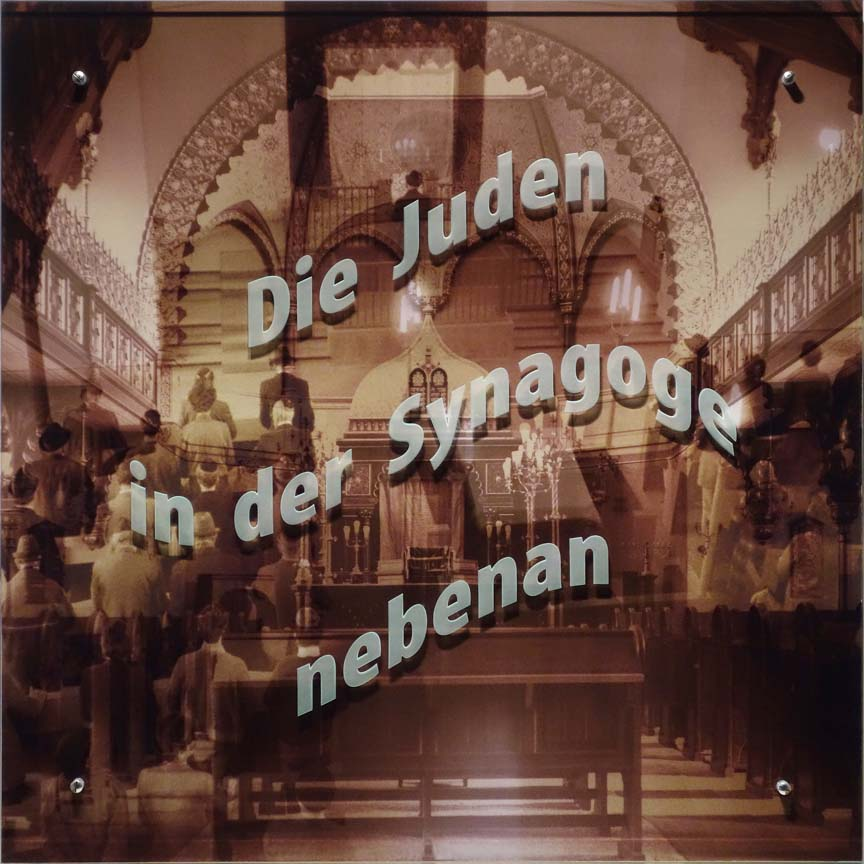 "Ken Aptekar, Die Juden in der Synagoge nebenan, 2015, digital archival inkjet print on paper mounted to wood panel, sandblasted glass, bolts, (English translation: ""The Jews in the Synagogue nextdoor"")"
